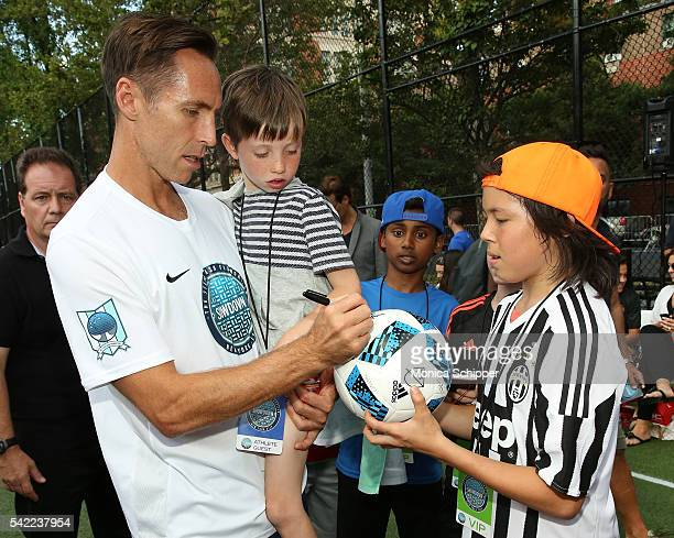 Retired professional basketball player and founder of the Steve Nash Foundation Steve Nash accompanied by son Matteo Joel Nash signs at autograph at...