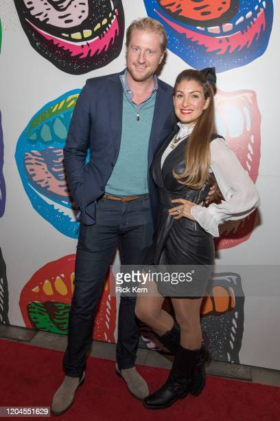 Retired professional basketball player Bradley Buckman and activist Alexis Jones attend the Voices for Justice fundraising event for Proclaim Justice...