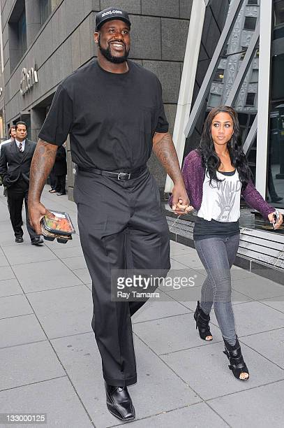 Retired professional basketball player Shaquille O'Neal and TV personality Nikki Hoopz Alexander enters Capital Grille restaurant on November 15 2011...