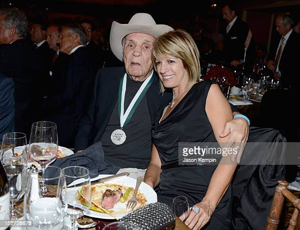 Retired professional boxer and former World Middleweight Champion Jake LaMotta and fiancee Denise Baker attend the 27th Annual Great Sports Legends...