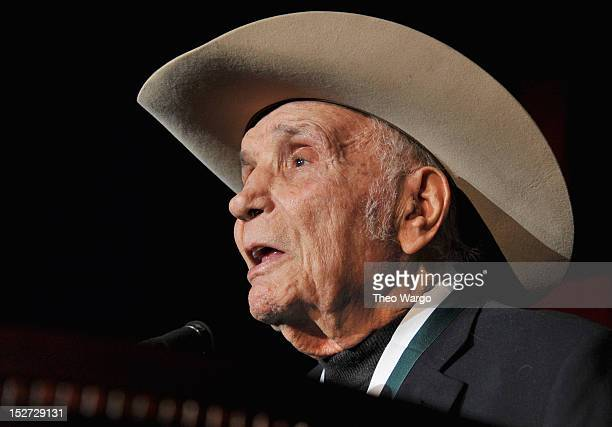 Retired professional boxer and former World Middleweight Champion Jake LaMotta speaks onstage at the 27th Annual Great Sports Legends Dinner to...