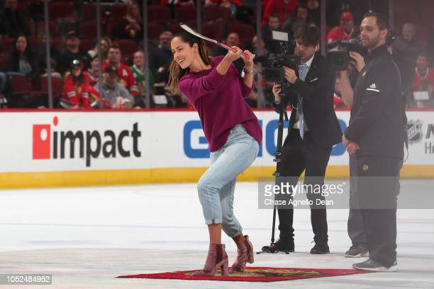 Retired professional tennis player Ana Ivanovic shoots the puck in between periods of the game between the Chicago Blackhawks and the Arizona Coyotes...