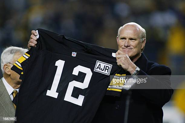 Retired Quarterback Terry Bradshaw of the Pittsburgh Steelers holds up his old number during the NFL game against the Indianapolis Colts at Heinz...