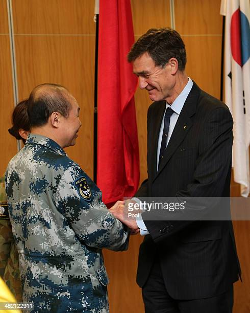 Retired RAAF Air Marshall Angus Houston meets with Chinese crewman involved in the search for wreckage and debris of missing Malaysia Airlines MH370...