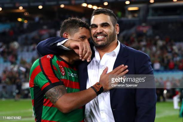 Retired Rabbitoh Greg Inglis embraces team mate Dane Gagai of the Rabbitohs following the round eight NRL match between the South Sydney Rabbitohs...