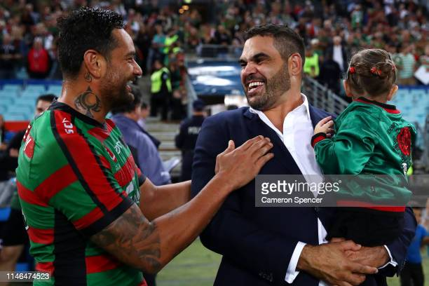 Retired Rabbitoh Greg Inglis talks to team mate John Sutton of the Rabbitohs following the round eight NRL match between the South Sydney Rabbitohs...