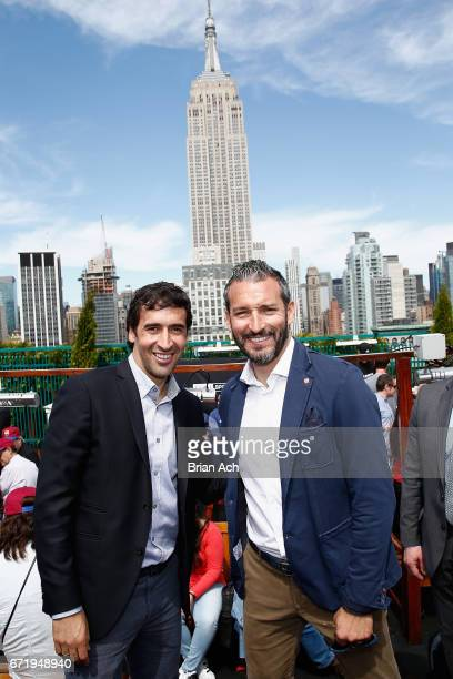 Retired soccer players Raul Gonzalez and Gianluca Zambrotta attend a roofop viewing party of El Clasico Real Madrid CF vs FC Barcelona hosted by...