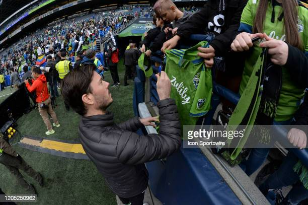 Retired Sounder Brad Evenas signs autographs after an MLS match between the Chicago Fire and the Seattle Sounders at Century Link Field in Seattle WA