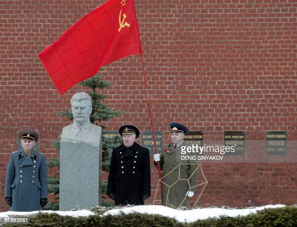 Retired Soviet officers salute standing next to the Joseph Stalin tomb outside the Kremlin wall in Moscow marking the Soviet leader's birthday 21...