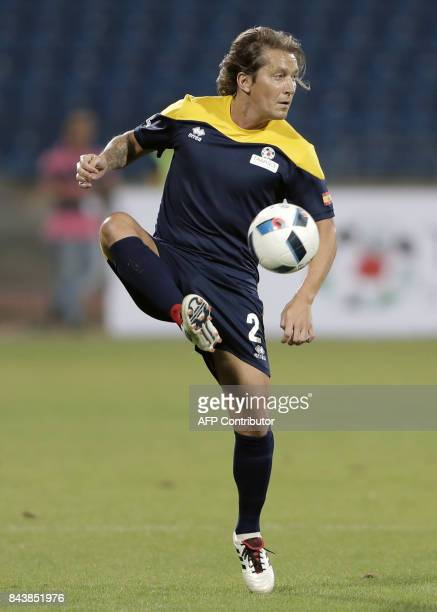 Retired Spanish former football player Michel Salgado receives the ball during a friendly match organised by Tawasol for Media and Sports between...