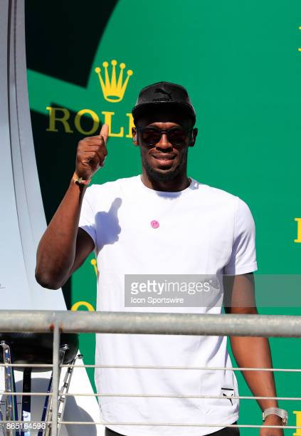 Retired sprinter Usain Bolt gives the fans a thumbs up after the United States Grand Prix on October 22 at the Circuit of The Americas in Austin TX