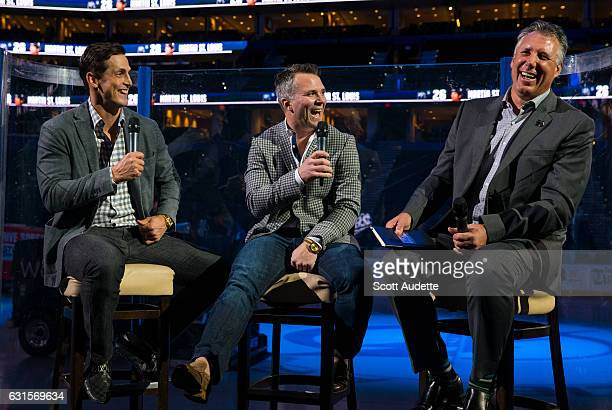 Retired Tampa Bay Lightning player Martin St Louis speaks with former teammates Vincent Lecavalier and Dave Andreychuk during a QA session the day...