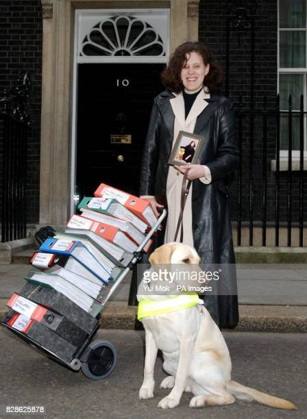 Retired teacher from Nottingham Jenny Hollingworth whose previous Guide Dog retired due to firework trauma with Kenna the Guide Dog outside No 10...