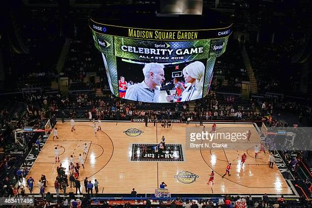 Retired tennis champion and team coach John McEnroe is seen being interviewed by sportscaster Jill Martin on the jumbotron during the NBA AllStar...
