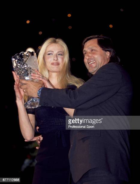 Retired tennis player Ilie Nastase of Romania with Dutch model Karen Mulder at an awards event during the Monte Carlo Open at the Monte Carlo Country...