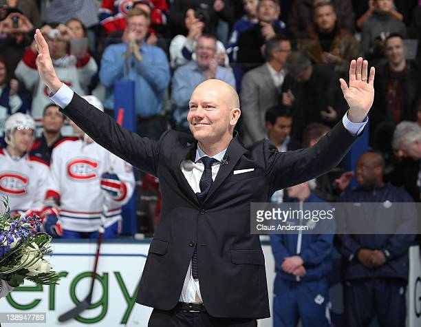 Retired Toronto Maple Leaf legend Mats Sundin salutes the crowd on an evening honouring his number 13 prior to a game between the Montreal Canadiens...