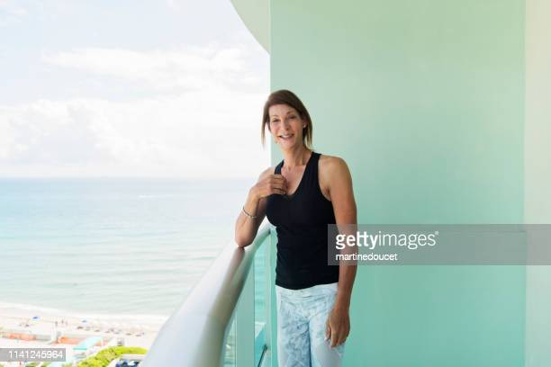 """retired trans woman doing yoga on balcony. - """"martine doucet"""" or martinedoucet fotografías e imágenes de stock"""