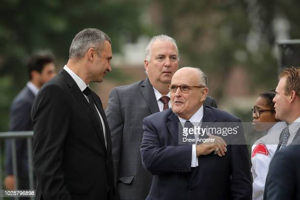 Retired Ukrainian boxer Wladimir Klitschko talks with Rudy Giuliani as they arrive at the Washington National Cathedral for the funeral service for...