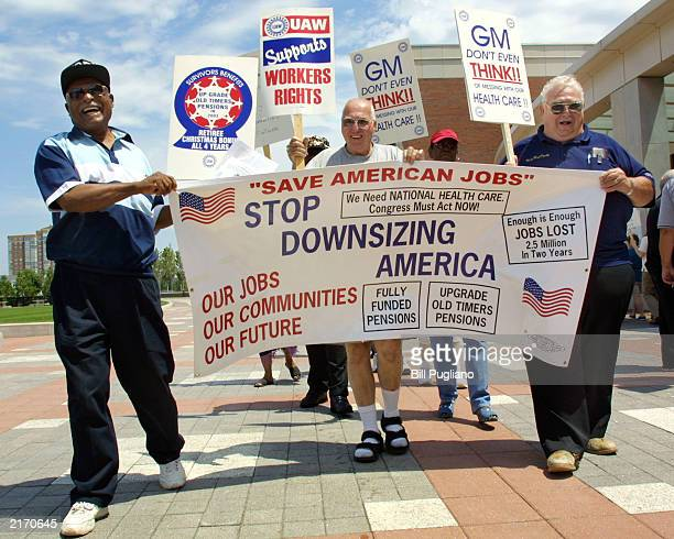Retired United Auto Workers members picket the General Motors/UAW negotiations outside the UAWGM Center for Human Resources July 17 2003 in Detroit...
