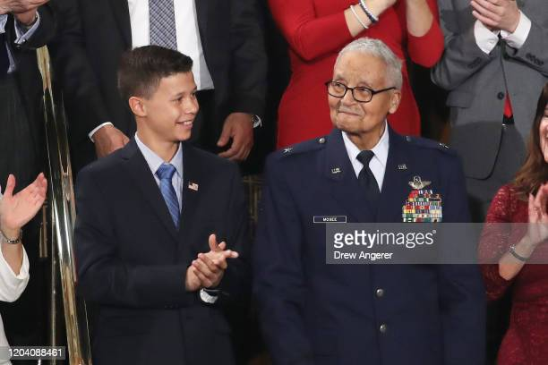 Retired U.S. Air Force Col. Charles McGee, who served with the Tuskagee Airmen, attends the State of the Union address with his great- grandson Iain...
