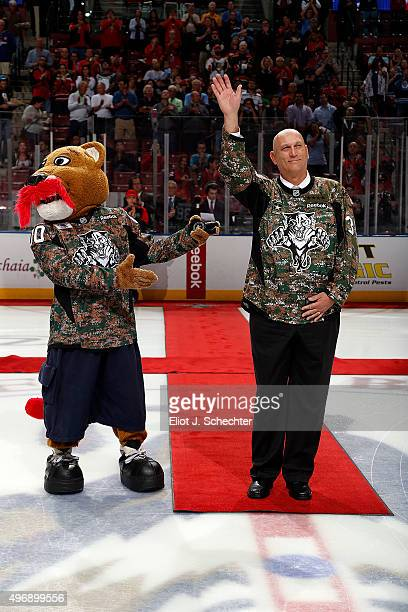 Retired US Army Chief of Staff Gen Raymond T Odierno gets set to drop the ceremonial puck prior to the start of the game between the Florida Panthers...