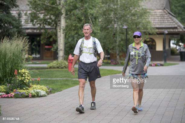 Retired US Army General Stan McChrystal chairman of Siemens Government Technologies Inc arrives with his wife Annie McChrystal for the morning...