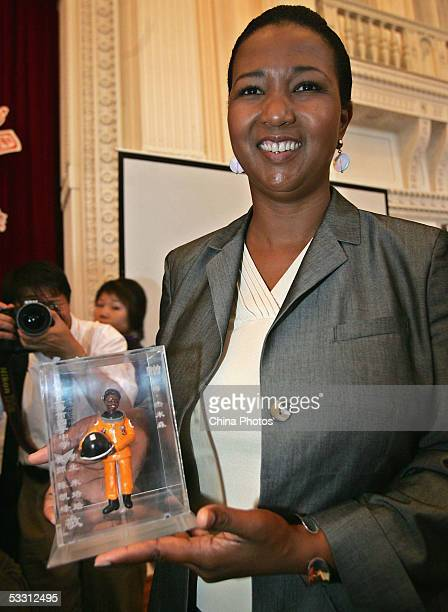 Retired US astronaut Mae C Jemison displays a sculpture featuring her which was presented to him as a gift from Chinese children at the Shanghai...