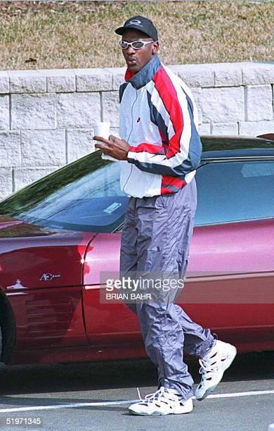Retired US basketball star Michael Jordan arrives at the Berto Center the Chicago Bulls practice facility in Deerfield Illinois 18 March Jordan has...