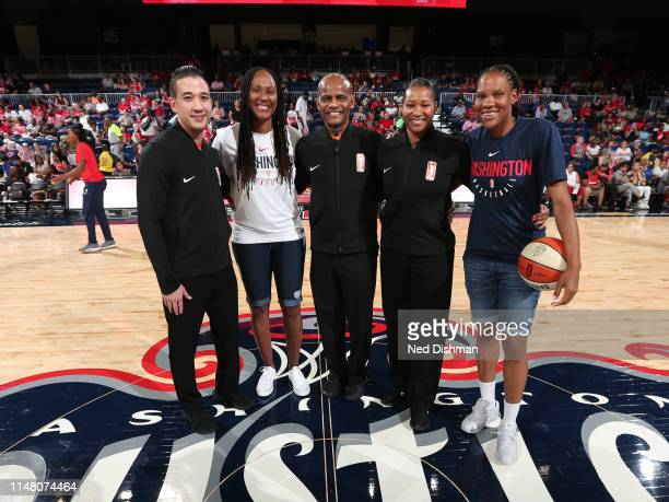 Retired WNBA Players Chamique Holdsclaw and Monique Currie pose for a photograph with referee officials Isaac Barnett Jeff Smith and Janetta Graham...