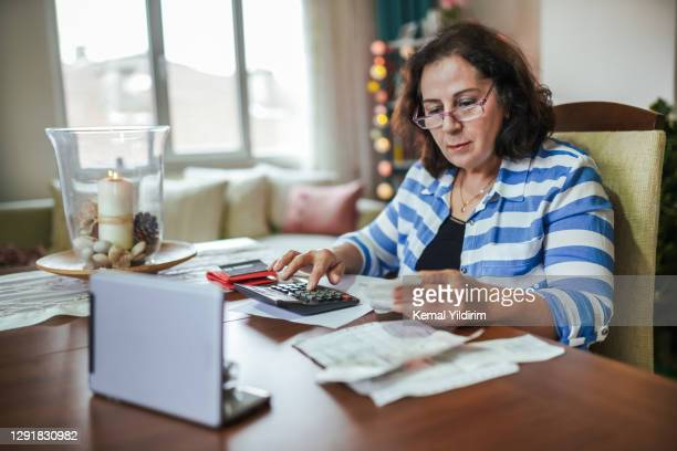 retired woman managing on a low income - retirement stock pictures, royalty-free photos & images