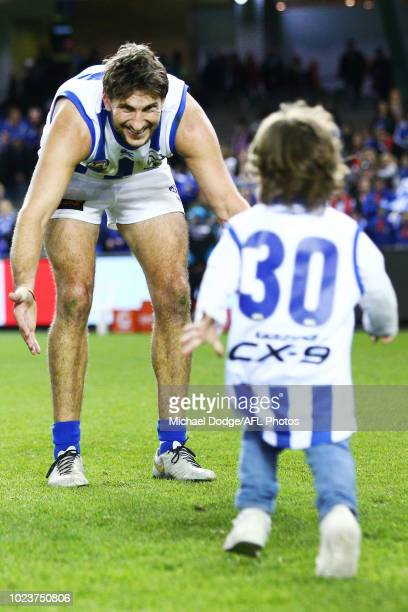 Retiree Jarrad Waite of the Kangaroos is greeted by his kids after the final siren during the round 23 AFL match between the St Kilda Saints and the...