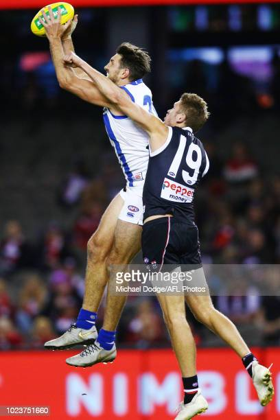 Retiree Jarrad Waite of the Kangaroos marks the ball against Sam Gilbert of the Saints during the round 23 AFL match between the St Kilda Saints and...