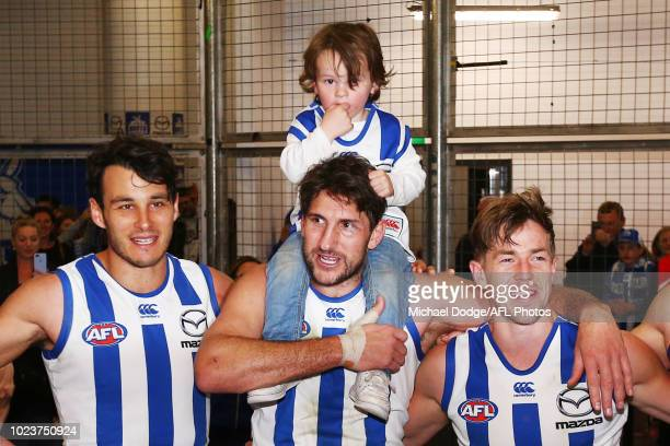 Retiree Jarrad Waite of the Kangaroos sing the club song after winning with his kids during the round 23 AFL match between the St Kilda Saints and...