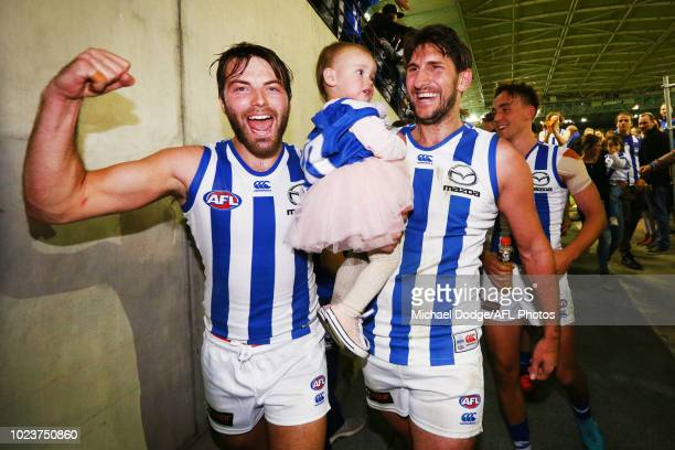 Retiree Jarrad Waite of the Kangaroos walks off with his kids and Luke McDonald of the Kangaroos after the final siren during the round 23 AFL match...