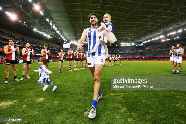 Retiree Jarrad Waite of the Kangaroos walks off with his kids during the round 23 AFL match between the St Kilda Saints and the North Melbourne...