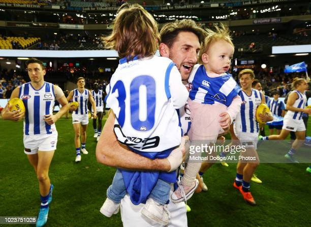 Retiree Jarrad Waite of the Kangaroos walks on with his kids during the round 23 AFL match between the St Kilda Saints and the North Melbourne...