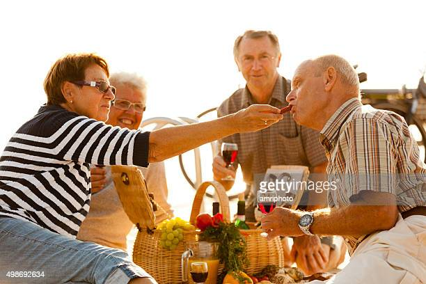 retiree people eating during picnic close up