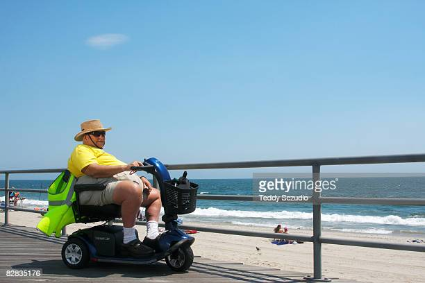retirement ad - mobility scooter stock photos and pictures