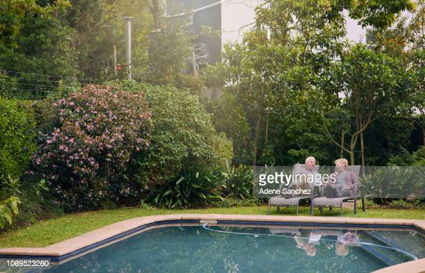 retirement brings the pleasure of many leisurely days - poolside stock pictures, royalty-free photos & images
