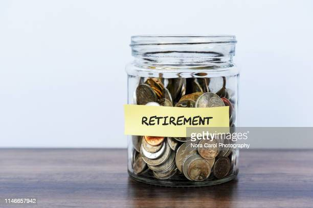 retirement coin jar - retirement stock pictures, royalty-free photos & images
