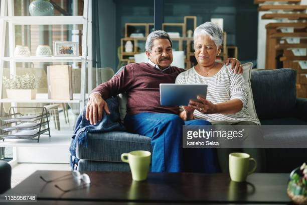 retirement gives us more time to relax and be connected - touchpad stock pictures, royalty-free photos & images