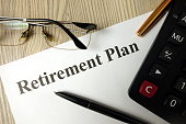 Retirement plan with calculator pen and glasses