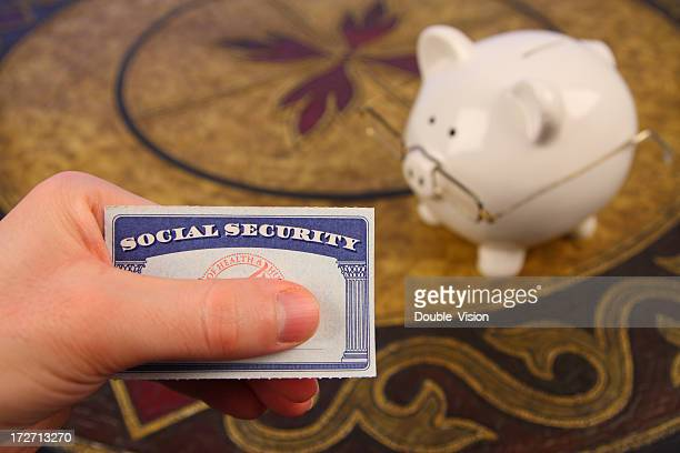 retirement savings: social security card and piggy bank with spectacles - social security stock pictures, royalty-free photos & images