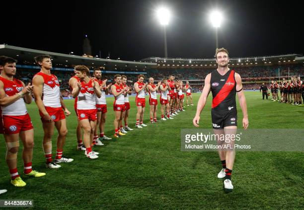 Retiring Bomber Jobe Watson leaves the field during the AFL Second Elimination Final match between the Sydney Swans and the Essendon Bombers at...