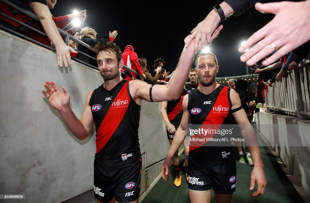 Retiring Bombers Jobe Watson (left) and James Kelly leave the field during the AFL Second Elimination Final match between the Sydney Swans and the Essendon Bombers at Sydney Cricket Ground on September 9, 2017 in Sydney, Australia.
