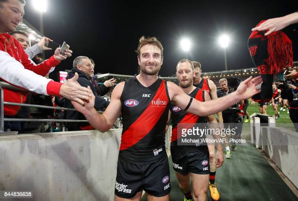 Retiring Bombers Jobe Watson and James Kelly leave the field during the AFL Second Elimination Final match between the Sydney Swans and the Essendon...