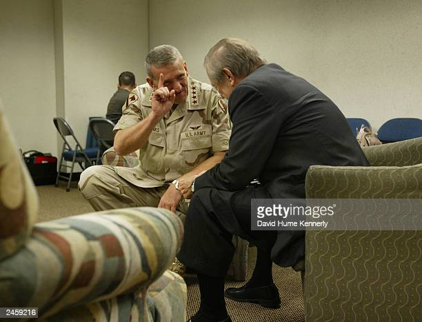 Retiring Commander of CENTCOM General Tommy Franks meets with Secretary of Defense Donald Rumsfeld before his changeofcommand ceremony July 7 2003 in...