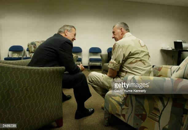 Retiring Commander of CENTCOM General Tommy Franks meets with Secretary of Defense Donald Rumsfeld before his change-of-command ceremony July 7, 2003...