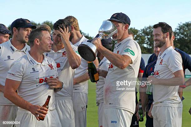 Retiring cricketer David Masters of Essex drinks from the trophy after winning Division Two at the end of day 4 of the Specsavers County Championship...