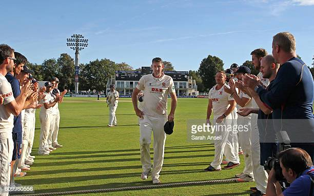 Retiring cricketer David Masters of Essex walks off the field through a guard of honour at the end of day 4 of the Specsavers County Championship...